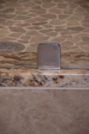 Glass shower hardware detail