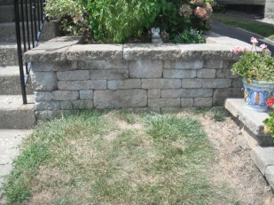 Landscaped stone wall after